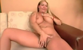 Blonde milf with big milk jugs is having casual sex with her husband, on the sofa