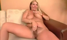 Busty brunette with tanlines is having a blast while drilling her tight pussy with a sex toy