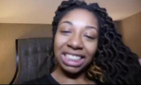 Ebony beauty spreads her pussy